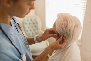 Female physician caring for senior woman